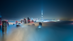 Dubai skyline above the clouds wallpaper